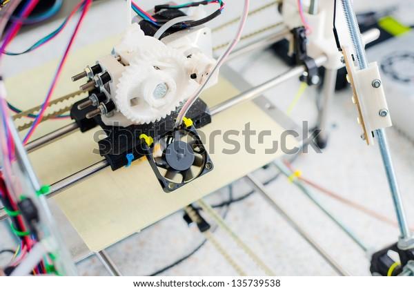 Electronic three dimensional plastic printer during work in school laboratory, 3D printer, 3D printing