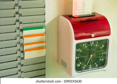 Electronic time recorder By inserting a card.
