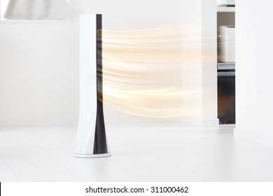 Electronic tower fan blowing warm air