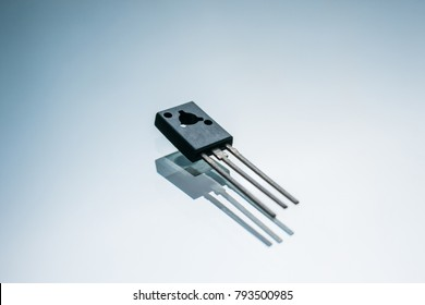 electronic transistor on white background. current control in output circuit. amplification and conversion of electrical signals