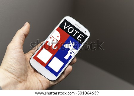 Electronic voting on a mobile phone. In this case the phone has two options, red and blue, white a white elephant and a donkey.