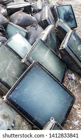 Electronic waste ready for recycling,Abandoned tv,old TV garbage, rubbish, electronic junk, Recycling Electronics, Pile of broken television stacked for disposal,selection focus on image