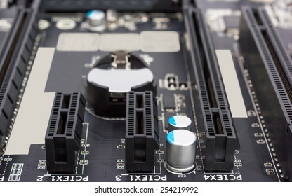 Electronics components on modern PC computer motherboard with PCI connector slot