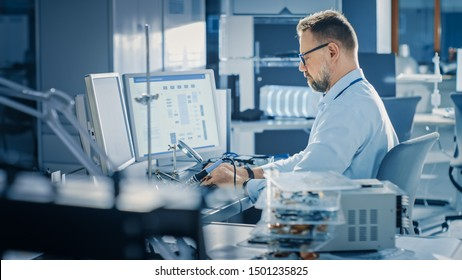 Electronics Development Engineer Working on Computer, Designing Motherboard, Doing Maintenance of Devices and Soldering Circuit Boards. Professional working in Bright and Modern Office