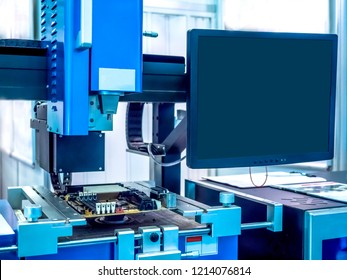 Electronics manufacturing. The robot collects the computer. Automation in production. Electric circuits. Technology development.
