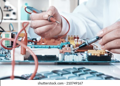 Electronics repair service, hands of female tech fixes an electronic circuit