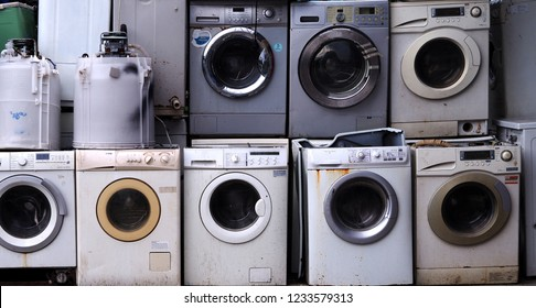 Electronics Washing machine waste old, used and obsolete electronic equipment for  recycle in factory industry.