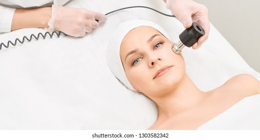 Electroporation woman face treatment. Facial rejuvenation therapy. Cosmetology skin spa equipment. Rf lifting. Massage device.