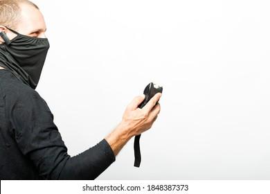 Electroshock Taser in hand isolated on white background. Stun gun, taser, electroshock protection against bandits, device for self-defense. Man with a lightning high voltage stun gun