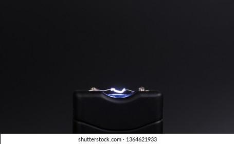 Electroshock Taser on a black background.