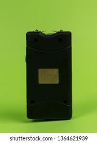 Electroshock Taser on a green background.