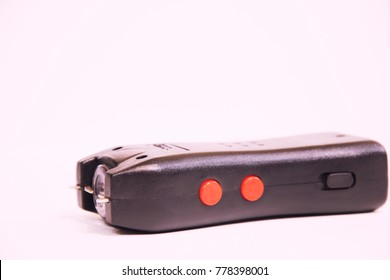 An Electroshocker on a white background. Self-defense tool.