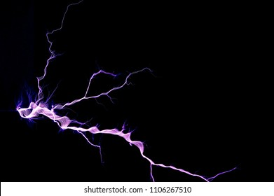 Electrostatic discharge. Electric discharge on black background. Artificially created spark discharge in the air.