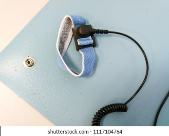 Electrostatic Discharge ESD bracelet on ESD mat. Protection against static electricity that damage electronics
