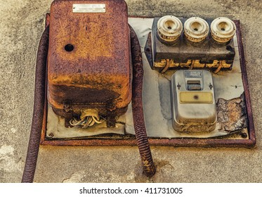 Electrotechnical industrial archeology - old electric light switch and electrical panel with valves and fuses