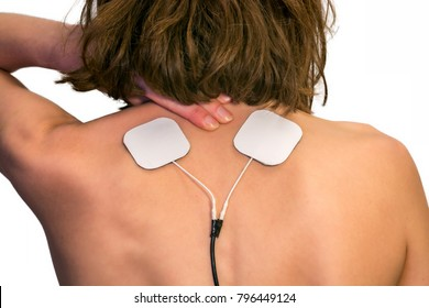 Electrotherapy for pain in the shoulder area of a woman