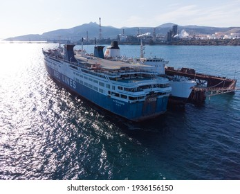 """Elefsina, Greece - March, 2020. Aerial photo of the legendary ship """"Mytilene"""" of NEL Lines Company is decommissioned at a dock in the port of Elefsina"""