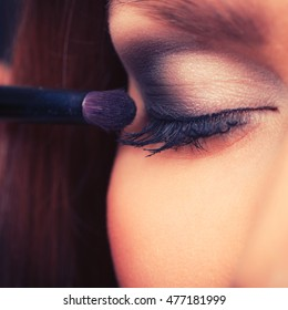 Elegance and beauty of women. Close up of female face with beautiful elegant dark eye make up. Young woman with stunning amazing facial look.