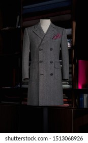 Elegance bespoke cashmere winter-coat on a mannequin. Men's Clothing.