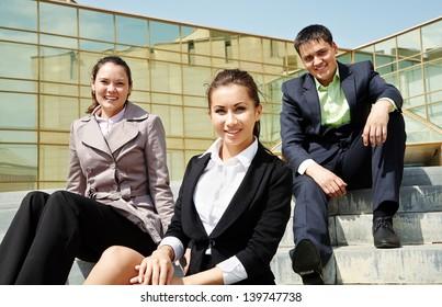 Elegance businesspeople sitting near office