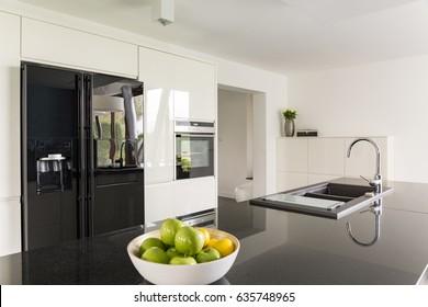 Elegance in kitchen interior with fridge and marble worktop
