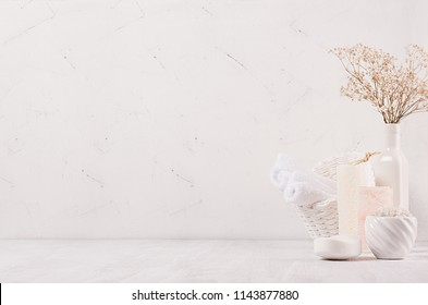 Elegance light soft white homemade cosmetics set of products for body care and bath accessories with white dry flowers in light soft interior, copy space.