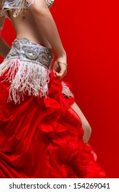 An Elegance red dress Belly dancer girl in action. With Red background