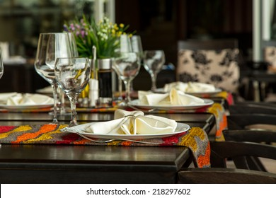 Elegance shot of fine dinning set in hotel restaurant. Vacation and leisure theme.