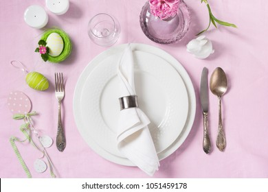 Elegance table setting spring pink hyacinth flowers on with pink linen tablecloth. Easter romantic dinner. Top view.