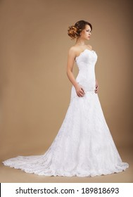 Elegance. Young Graceful Newlywed in Long Dress