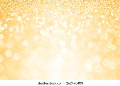 Elegant abstract gold glitter sparkle confetti burst background or golden party invite for happy birthday card, anniversary poster, wedding pattern, gala flyer, New Year's Eve or Christmas design