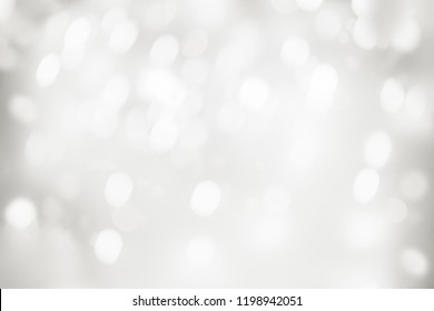 Elegant Abstract Silver Christmas Background with white bokeh lights for Holiday Poster, Banner, Ad, Card or invitation.