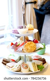 elegant afternoon high tea with finger sandwiches and sweets