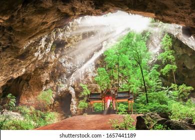Elegant ancient pavilion inside the hidden cave, sunbeam shines through large hole down on the pavilion. Phraya Nakhon Cave, travel destinations in Prachuap Khiri Khan, Thailand. Focus on pavilion.