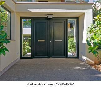 elegant apartment building entrance green metallic door, Athens Greece