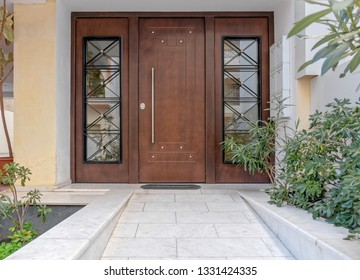 Elegant apartments building wood and glass door, Athens Greece