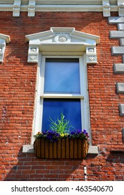 Elegant architecture enhances this window and flower box, in Bozeman, Montana.