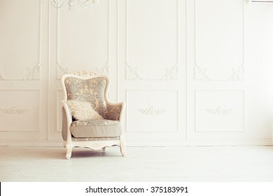 elegant armchair in luxury clean bright white interior