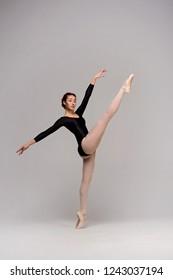 Elegant ballerina dancing in the studio.