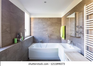 Elegant bathroom with dark tiles. Nobody inside