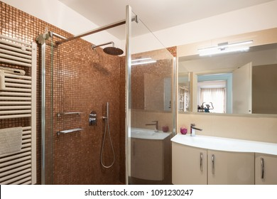 Elegant bathroom with large sink and mirror. Nobody inside