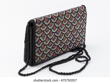 Elegant beaded black, silver and blue female clutch isolated on white