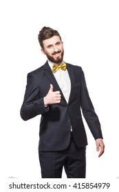 elegant bearded man in suit, bow tie with thumb up
