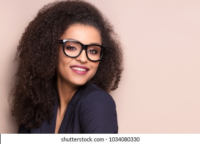 Elegant beautiful african american woman wearing fashionable eyeglasses. Girl with afro hairstyle.