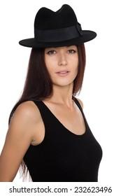 Elegant beautiful girl in a black felt hat. Twenty-seven years old.