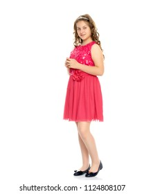Elegant, beautiful girl in a dress. In full growth. The concept of youth fashion, happy childhood. Isolated on white background.
