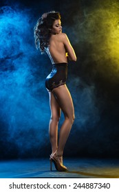 Elegant beautiful sexy woman posing in sensual lingerie, looking at camera