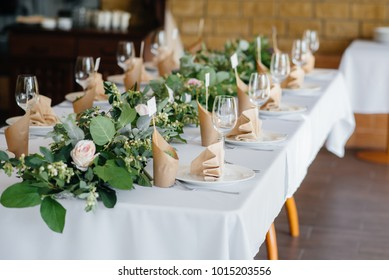 Elegant and beautifully set tables for a festive banquet.