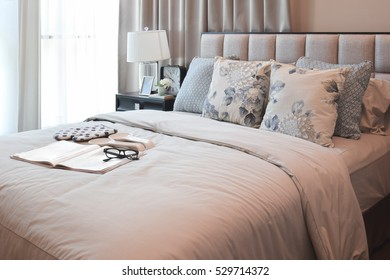 elegant bedroom interior design with floral pattern pillows on bed and  decorative table lamp. 37ebca86a