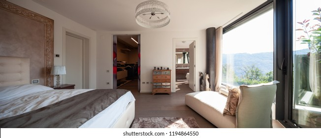 Elegant bedroom in modern apartment. Nobody inside